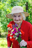 Elderly with a bouquet Stock Photos