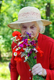 Elderly with a bouquet Stock Photography