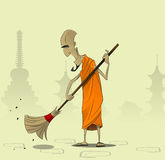 Elderly Buddhist monk sweeps the courtyard of the monastery Royalty Free Stock Photo