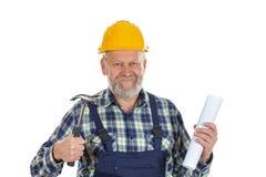 Elderly builder with spirit level tool Stock Photography