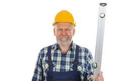 Elderly builder with spirit level tool Royalty Free Stock Images