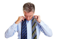 Elderly business man comparing ties Stock Photos
