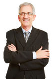 Elderly business man with his arms crossed. Elderly smiling business man with glasses having his arms crossed Stock Photos