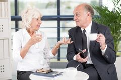 Elderly business partners discussing Stock Photos