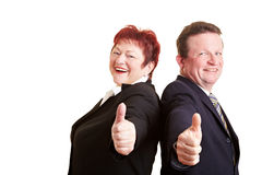 Elderly business people holding Royalty Free Stock Images