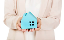 Elderly business woman holding blue paper house Stock Photos