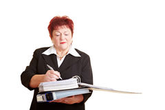 Elderly business woman taking notes Royalty Free Stock Photos