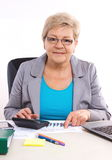 Elderly business woman working at her desk in office, analysis of sales plan, business concept stock photography