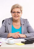 Elderly business woman working at her desk in office, business concept royalty free stock photos