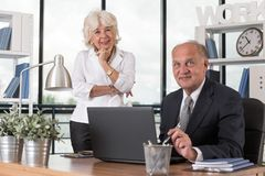 Elderly businessman and businesswoman Stock Image