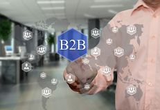 An elderly businessman chooses B2B, Business to business on the stock image