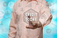 An elderly businessman chooses CREDIT SCORE button on the touch. Screen with a blur futuristic background Stock Images
