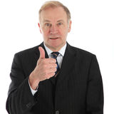 Elderly businessman giving thumbs up Royalty Free Stock Photos