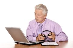 Elderly businessman with laptop Stock Photography