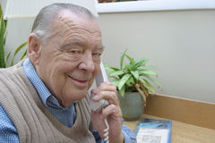 Elderly businessman on phone stock images