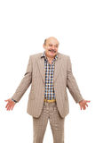 Elderly businessman shrugs from ignorance Royalty Free Stock Photos