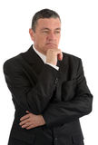 Elderly businessman is thinking about something isolated on whit Royalty Free Stock Photography