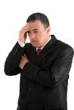 Elderly businessman is thinking about something isolated on whit Royalty Free Stock Photo