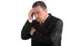 Elderly businessman is thinking about something isolated on whit Stock Photo