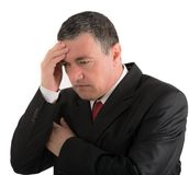 Elderly businessman is thinking about something isolated on whit Stock Photography