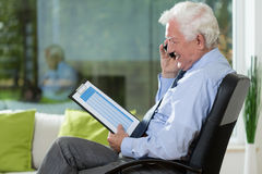 Elderly businessman working at home royalty free stock image