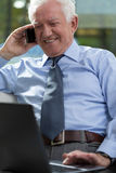 Elderly businessman working on laptop Royalty Free Stock Images