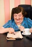 Elderly businesswoman reading newspaper Stock Photos