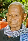 Elderly Cambodian Man. Elderly Cambodian gentleman posing for the camera in rural Cambodia Royalty Free Stock Photo