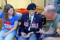 May 2018, Canadian war veteran medals heroes Liberation Day, Netherlands. Elderly Canadian war veteran with medals is vistiting Holland and talking to Dutch man royalty free stock photography