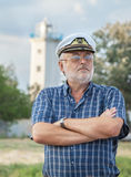 Elderly captain on the sea shore Stock Photography