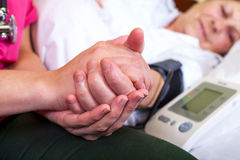 Elderly care. Close up picture of a bed ridden woman with high blood pressure Royalty Free Stock Photography