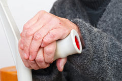 Elderly care. Close up picture of a handicap elderly woman`s hand Stock Images