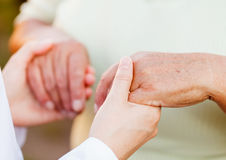Elderly care. Giving helping hands for needy elderly people Royalty Free Stock Photo