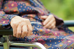 Elderly care. Handicapped elderly woman sitting in a wheelchair Stock Images