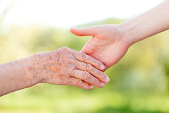 Elderly care. The helping hands for elderly home care royalty free stock photography