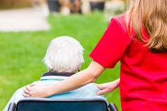 Elderly care. Photo of elderly women with the caregiver Royalty Free Stock Photography