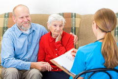 Elderly care. Photo of elderly women tells a story for the doctor Royalty Free Stock Image