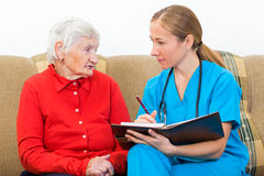 Elderly care. Photo of elderly women tells a story for the doctor royalty free stock images