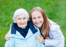 Elderly care. Portrait of elderly women and her caregiver Royalty Free Stock Photography