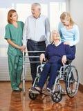 Elderly care with senior couple Stock Photos