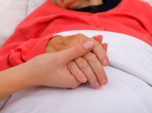 Elderly care. Elderly woman with her caregiver at home Royalty Free Stock Photos