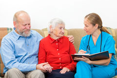 Elderly care. Elderly women and her son at the doctor royalty free stock image