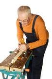 Elderly carpenter Stock Images