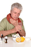 Elderly caucasian man treated by medicines Stock Photos