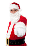 Elderly cheerful Santa pointing at you Royalty Free Stock Photo