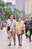 Elderly Chinese couple in city center, Shanghai, China Stock Image