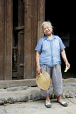 Elderly Chinese Lady at Daxu. Image of an elderly Chinese lady with fan and cucumber in hand at Daxu Ancient Town, Guilin, China Stock Images