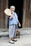 Elderly Chinese Lady at Daxu. Image of an elderly Chinese lady with fan and cucumber in hand at Daxu Ancient Town, Guilin, China Stock Photos