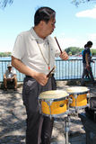 Elderly Chinese man playing drum in a park in Beijing Royalty Free Stock Photography