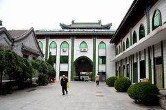 Elderly Chinese Muslim man walks in entrance courtyard of mosque Beijing China Stock Photos
